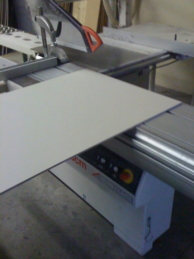 Sliding table saw being used to cut fiber cement panels